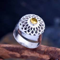 A silver Torus tube Ring set with Citrine.