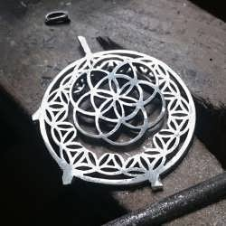 Creating a gold and silver model of a Flower of Life with the Seed of Life
