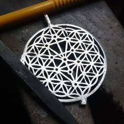 Working on a new version of the Flower of Life with the Tree of Life in it's center.