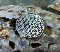 A new version of an inlaid Flower of life pendant with the pattern of the Tree of Life