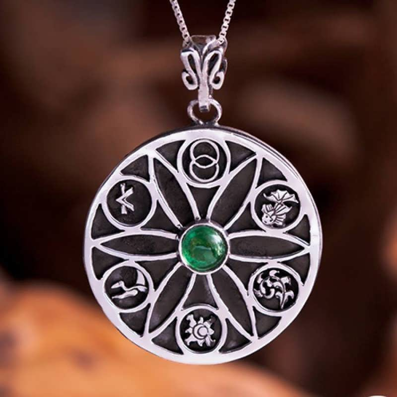 A silver version of the Genesis Pendant set with green Tourmaline.