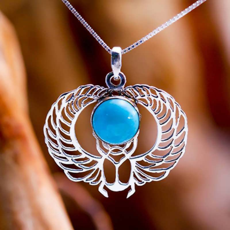 A silver Winged Egyptian Scarab set with turquoise