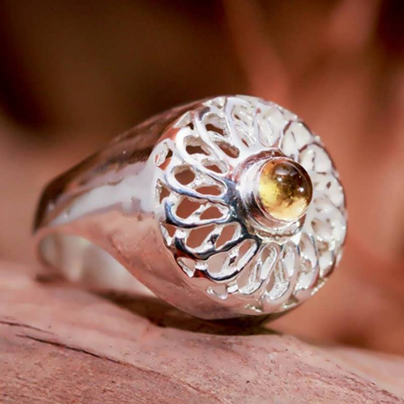 A silver Torus Knot ring set with Citrine