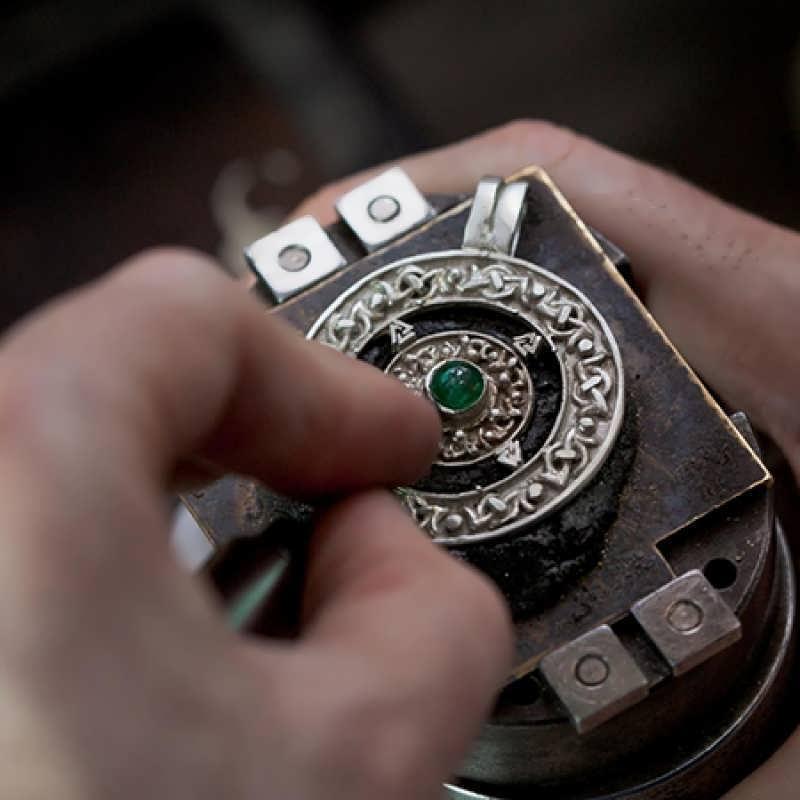 Setting a brilliant green Emerald in a Norse Amulet talisman