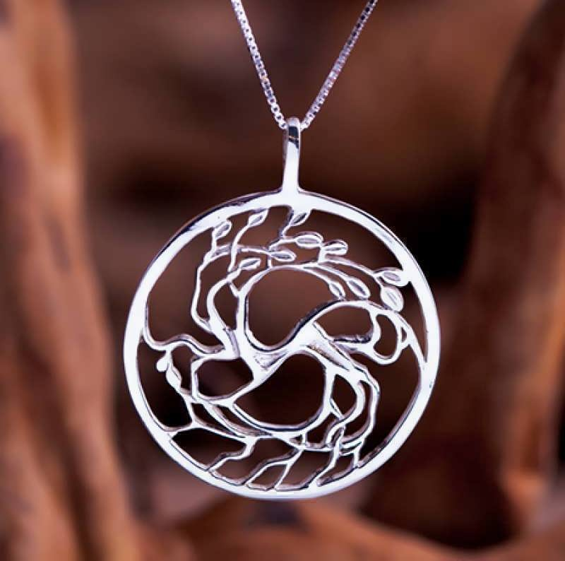A silver Tree of Love pendant
