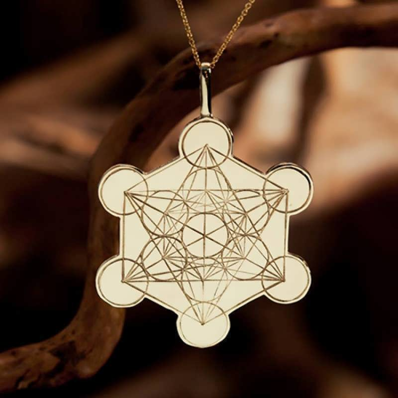 An engraving of Metatron's Cube in 14k gold.