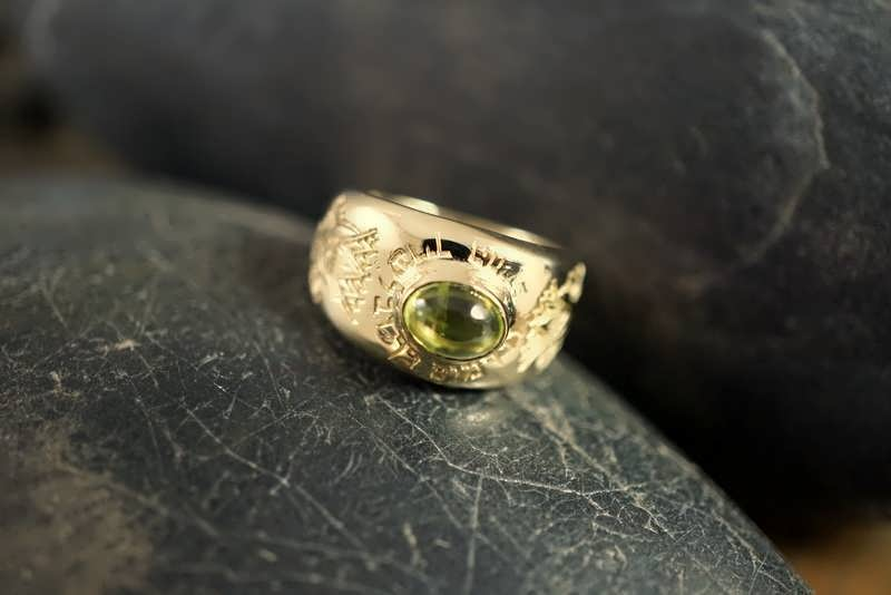 A gold lotus ring set with peridot