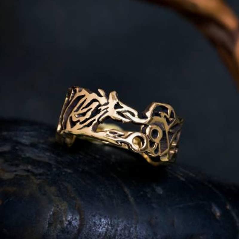 An 18k gold Ouroboros Ring