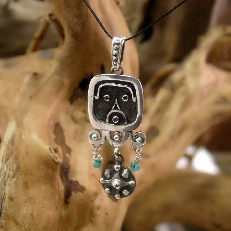 The Venus Mayan Talisman silver  set with rubies and diamonds.